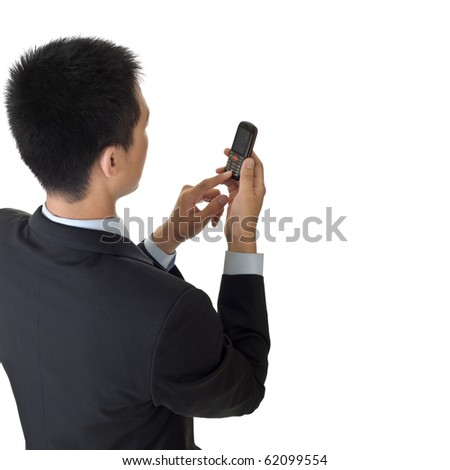 Business man holding cellphone with copyspace on white. - stock photo
