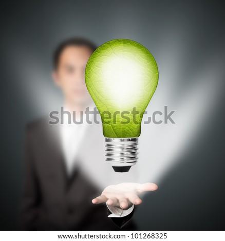 business man holding  eco green energy light bulb, future innovation concept - stock photo