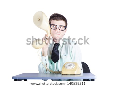 Business man holding enlarged telephone headset appearing to be eavesdropping or spying in a competition analysis concept