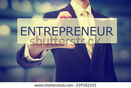 Business man holding Entrepreneur on blurred abstract background   - stock photo