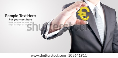 Business man holding euro currency sign. Concept for Europe economic crisis - stock photo