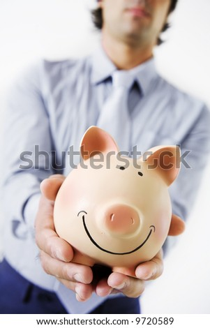 business man holding fat,happy piggybank