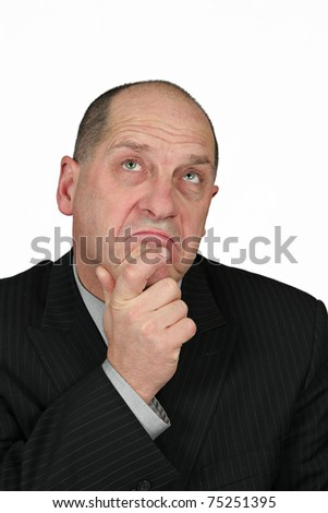 Business man holding finger up to his face - he is thinking - stock photo