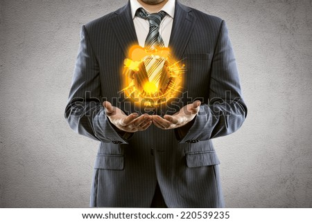 Business man holding fire balloon. Financial risk and crisis concept. Idea of overcoming economic difficulties in competitive world.  - stock photo