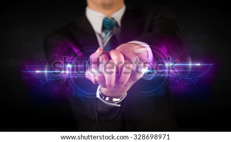 Business man holding future technology data system network concept - stock photo