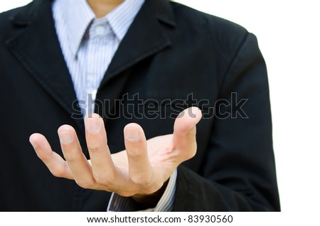 business man holding hand presenting a product. isolate on white background. - stock photo