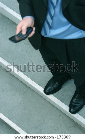 business man holding his cell phone