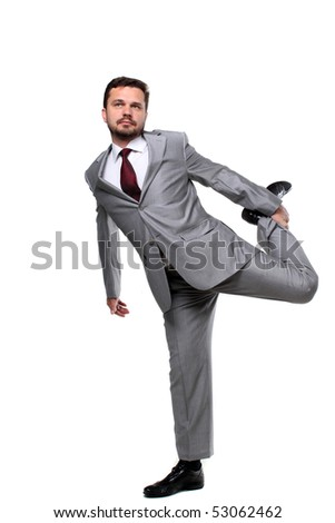 Business man holding his leg with a hand - stock photo