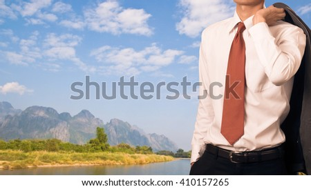 Business man holding his suit jacket on his shoulder, relax concept - stock photo