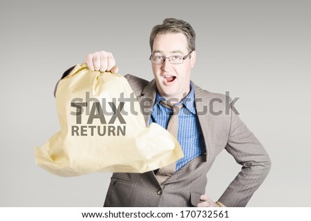 Business man holding income tax return with a happy expression of surprise. Big refund concept - stock photo