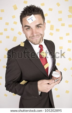 business man holding mobile-phone and cup of coffee with many posts - stock photo