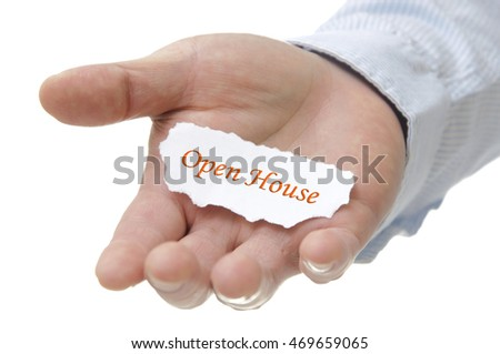 Business man holding open house note on hand