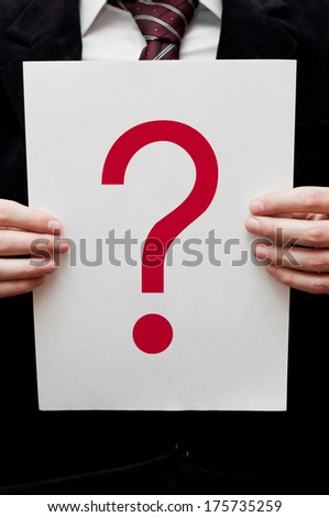 Business man holding paper with question mark  - stock photo