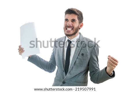 Business man holding papers getting very angry and raging isolated on white background with copy space for text. Office worker with anger management problems. Stressful office situation concept - stock photo