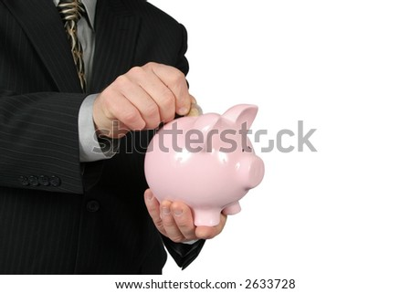 Business man holding Piggy Bank in front of him