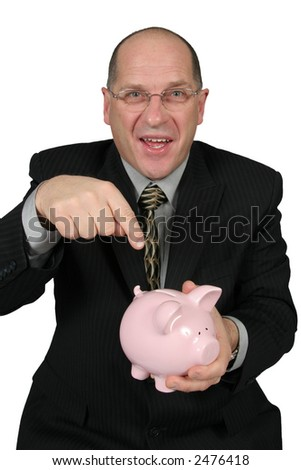 Business man holding Piggy Bank in front of him and pointing to it - stock photo