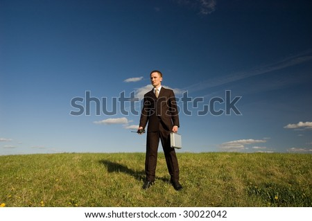 Business man holding portable radio and case