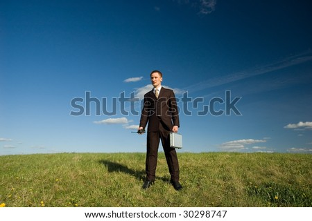 Business man holding portable radio and case - stock photo