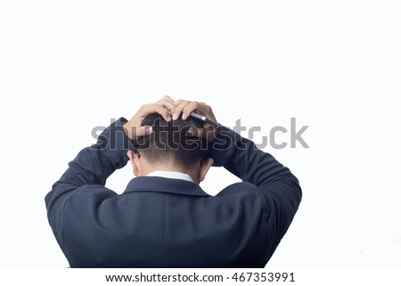 Business man holding smart-phone and Headaches after working Urgent  job with white background