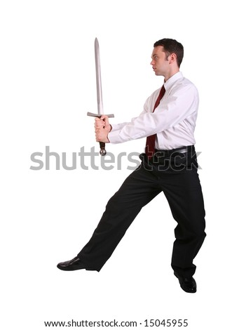 business man holding sword in martial arts pose - stock photo