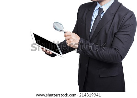 business man holding tablet and searching something by magnifier isolated on white background with clipping path - stock photo