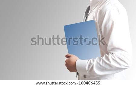 Business man holding tablet PC with blank blue screen - stock photo