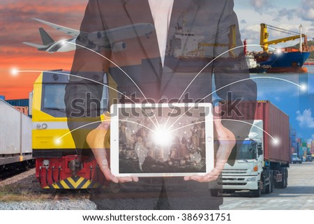 Business man holding tablet with transport background Concept  - stock photo
