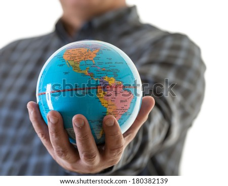 Business man holding the globe in his hands.
