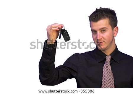 business man holding the keys for success - stock photo