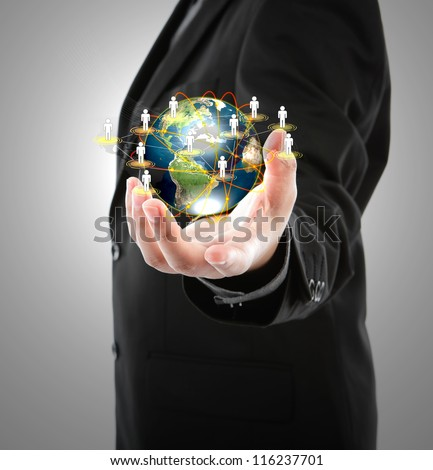 Business man holding the small world in his hands against white background (Elements of this image furnished by NASA) - stock photo