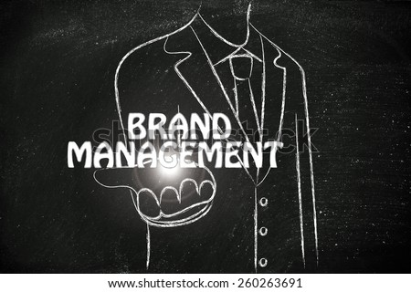 business man holding the word Brand Management - stock photo