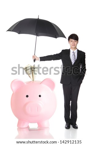 Business Man holding umbrella protect your money - stock photo