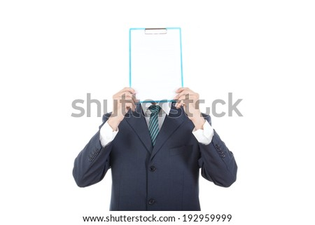 business man holding up a banner against a white background instead of his head. Cardboard placard is blank ready for your message. - stock photo