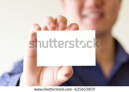 business man holding white business name card