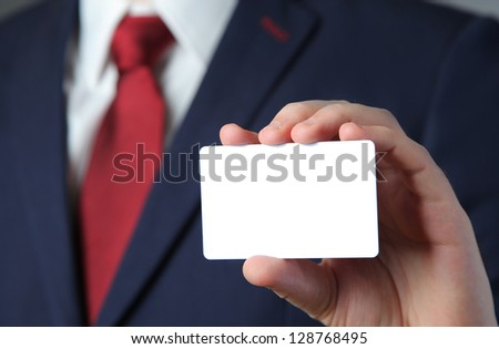 business man holding white card