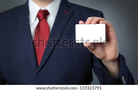 business man holding white card - stock photo
