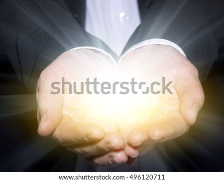 business man holding with powerful light in his hand