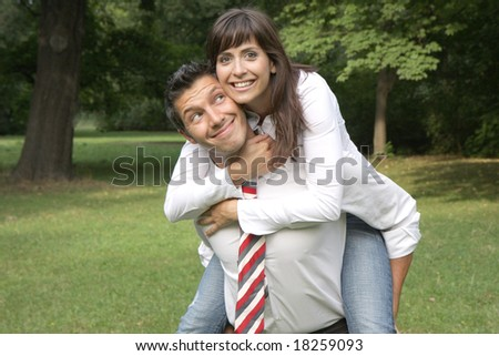 Business man holding young girl on back - stock photo