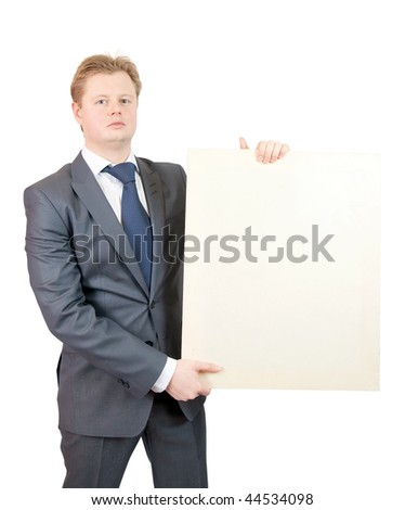 business man holds blank canvas. It is isolated on a white background - stock photo