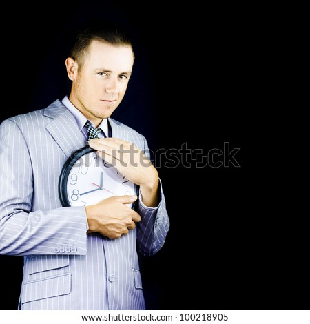 Business Man Hugging And Showing Love To A Clock In A Representation Of The Metaphor Time Is Money - stock photo