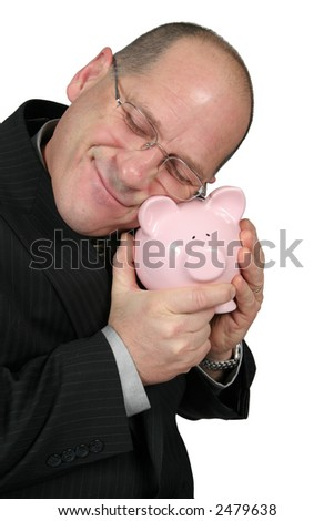 Business man hugging Piggy Bank and is very happy - stock photo