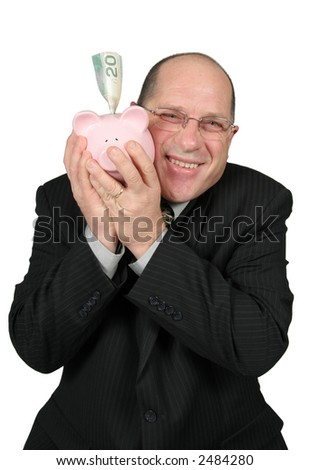 Business man hugging Piggy Bank happy to save money - stock photo