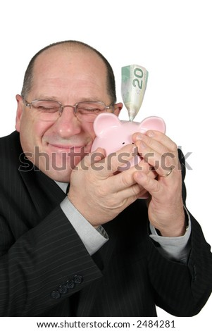 Business man hugging Piggy Bank with happy expression - stock photo