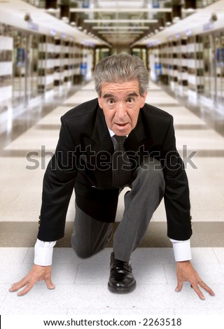 business man in a race position in a corporate environment - stock photo