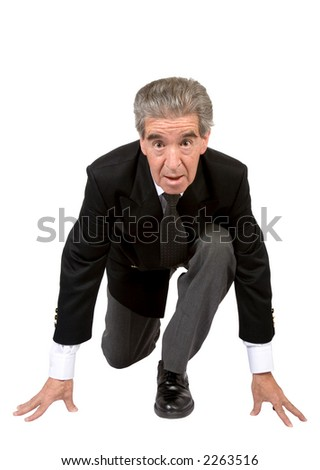 business man in a race position over a white background - stock photo