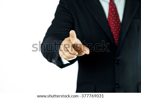 business man in a suit pointing on a screen isolated on white