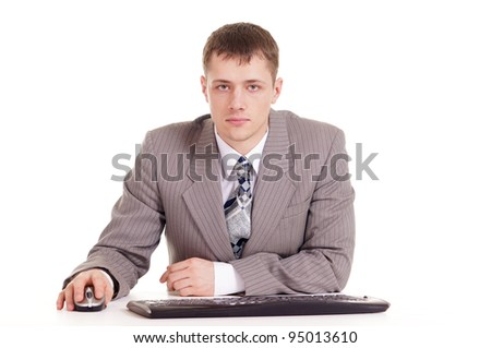 business man in a suit sitting at a laptop on a white background