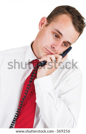 Business man in a suit with a blue telephone
