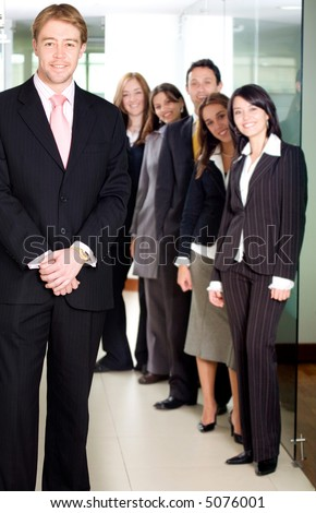 business man in an office with his team