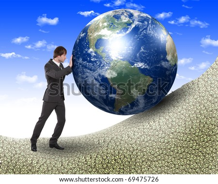 business man in black suit with a model of pour planet